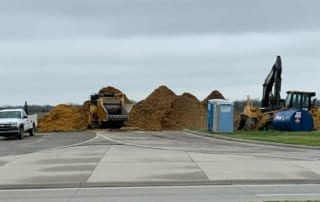 A white truck parks next to construction equipment and piles of debris at the site of the new TA Express travel plaza that is being built in Edgerton, KS.