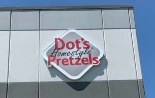 The Dot's Pretzels sign on the side of their new building